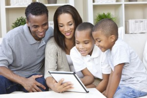 family at home using tablet